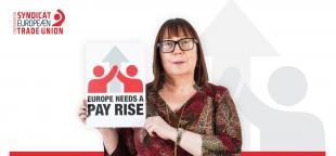 ETUC Deputy General Secretary Esther Lynch holding a sign saying: Europe needs a pay rise